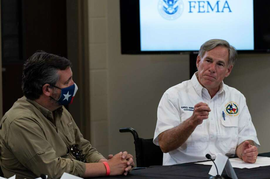 Sen. Ted Cruz, R-Texas, listens as Texas Gov. Greg Abbott speaks at a briefing with President Donald Trump about Hurricane Laura at the Orange County Emergency Operations Center, Saturday, Aug. 29, 2020, in Orange, Texas. (AP Photo/Alex Brandon) Photo: Alex Brandon, STF / Associated Press / Copyright 2020 The Associated Press. All rights reserved.