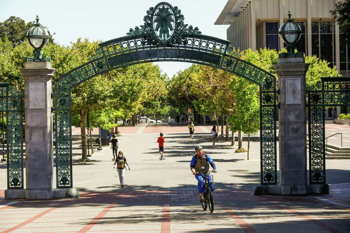 A smattering of people make their way through the University of California, Berkeley campus in July. COVID-19 has changed college admissions this year, and perhaps for the long-term.