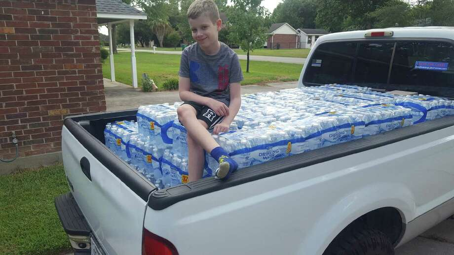 Gunnar Ruthstrom, 7, of Lake Conroe helped collect and deliver a truck load of water to those impacted by Hurricane Laura in Louisiana. Photo: Photo Courtesy The Ruthstrom Family