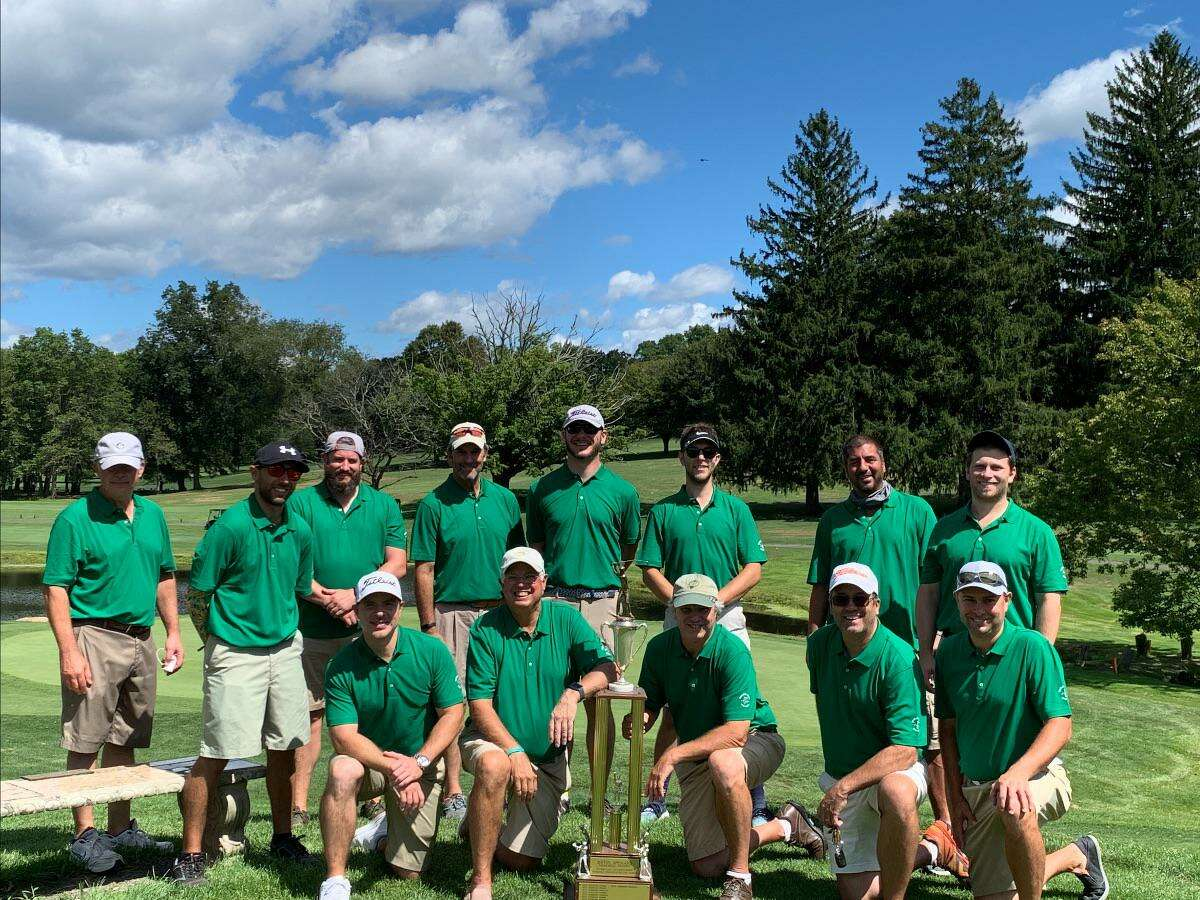 The Sterling Farms Men's Club poses with the Stamford Interclub trophy after beating the team from E. Gaynor Brennan on Aug. 20, 2020.