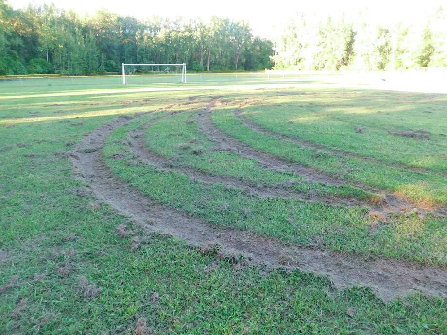 "The soccer fields at Mills Township Park were damaged by unknown suspects doing ""donuts"" in off-road vehicles on Aug. 30, 2020. (Photo provided/ Midland County Sheriff's Office)"