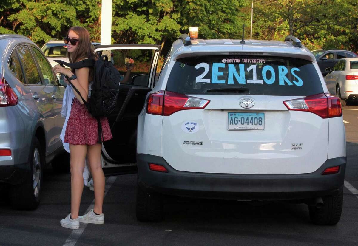 Fairfield Ludlowe High School students arrive for the first day of school for Fairfield Public Schools in Fairfield, Conn., on Tuesday Sept. 8, 2020.