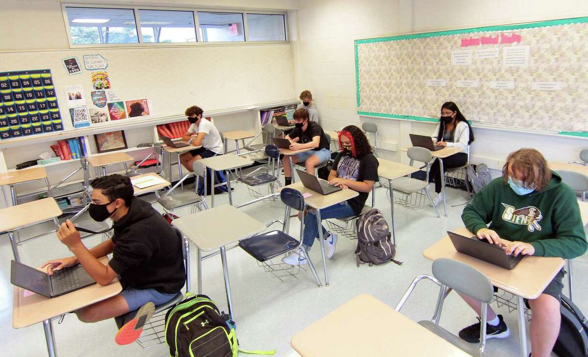 Fairfield Ludlowe High School students attend a class during the first day of school for Fairfield Public Schools in Fairfield, Conn., on Tuesday Sept. 8, 2020.
