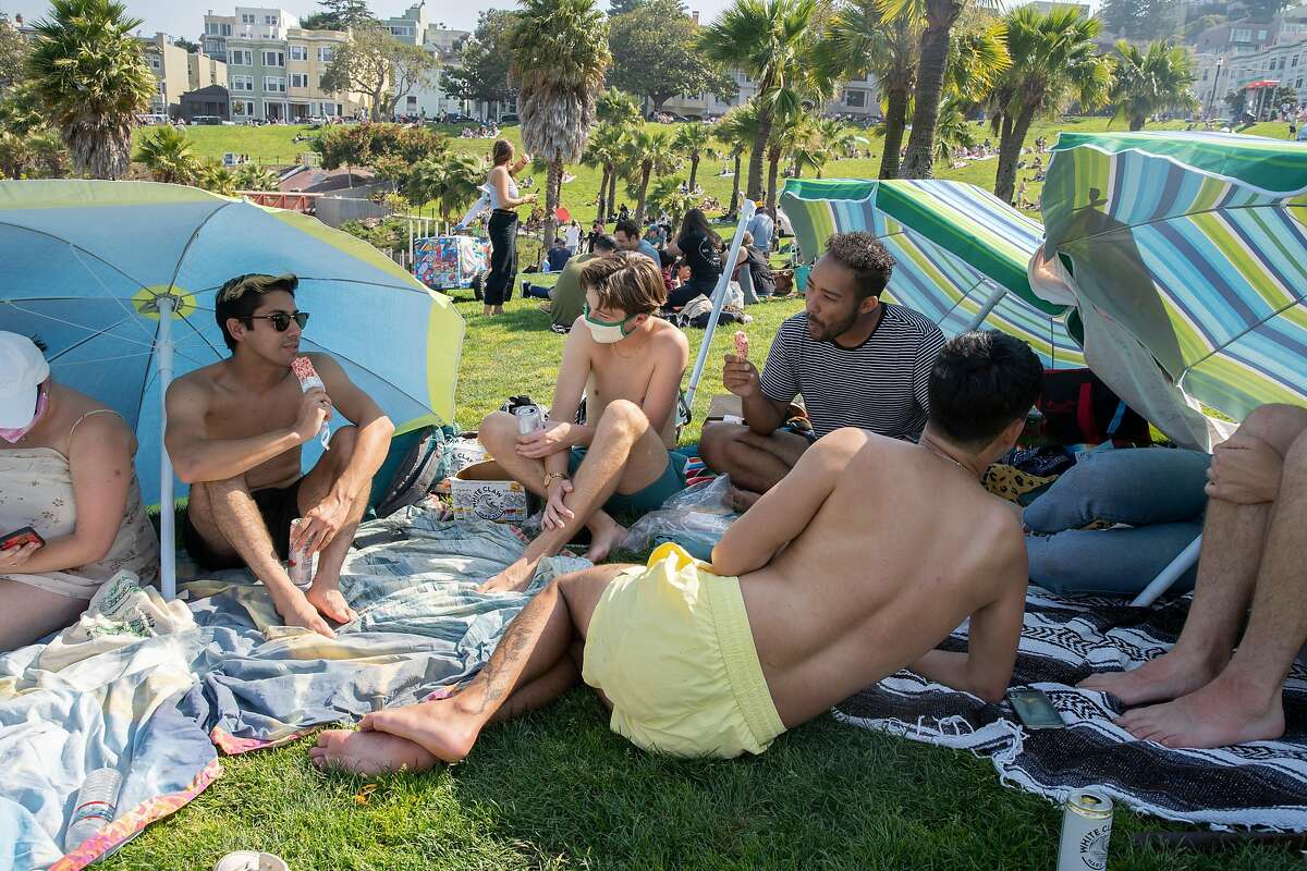 People gather during the Labor Day weekend at Dolores Park, Saturday, Sept. 5, 2020, in San Francisco, Calif.