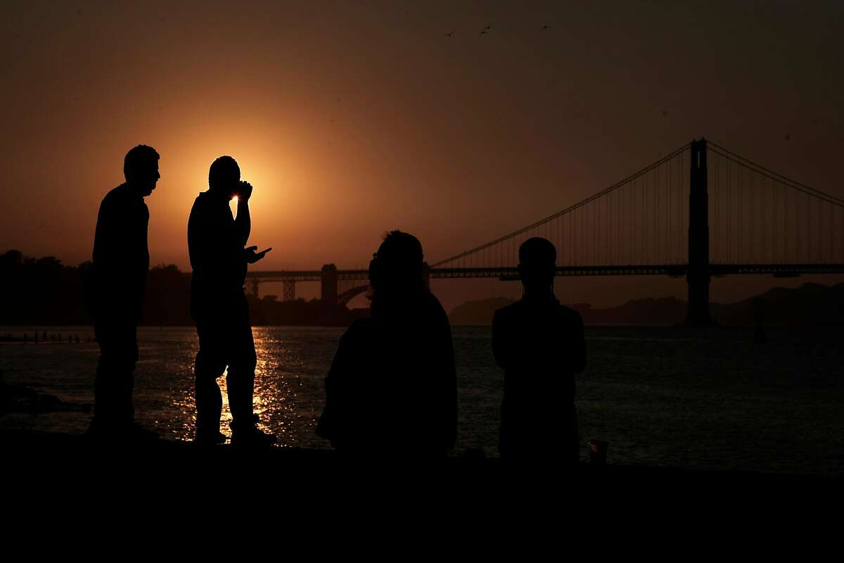 Visitors watch the sunset as they took advantage of the cooler temperatures at Crissy Field in San Francisco as hot weather in September toppled records all over the Bay Area. A good portion of the state is now suffering drought conditions that could worsen this winter.