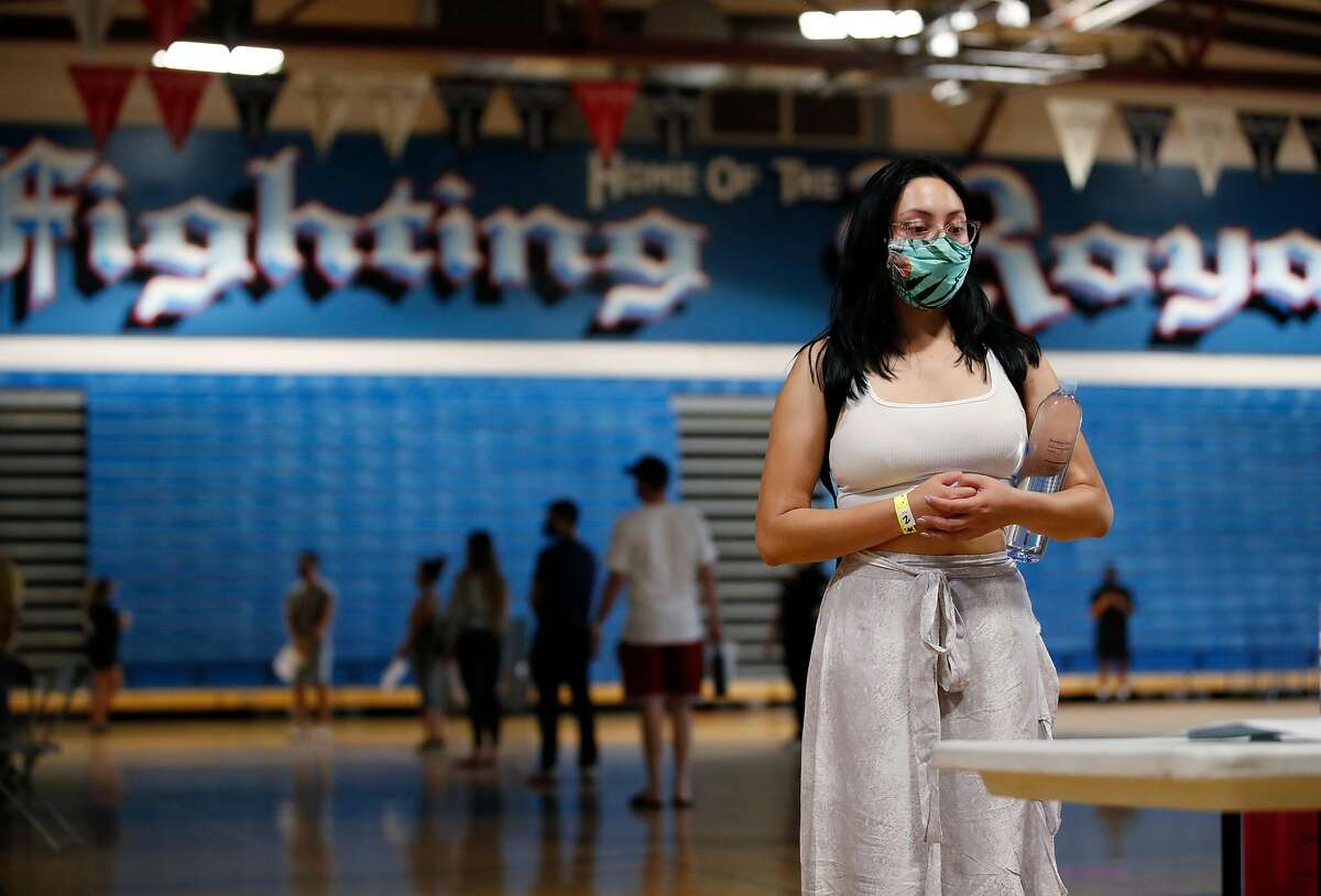 Emma Ramirez, waits to be registered to be tested at the Santa Clara County, COVID-19 pop-up testing site at William C. Overfelt High School in San Jose, California, on Thursday, August 13, 2020.