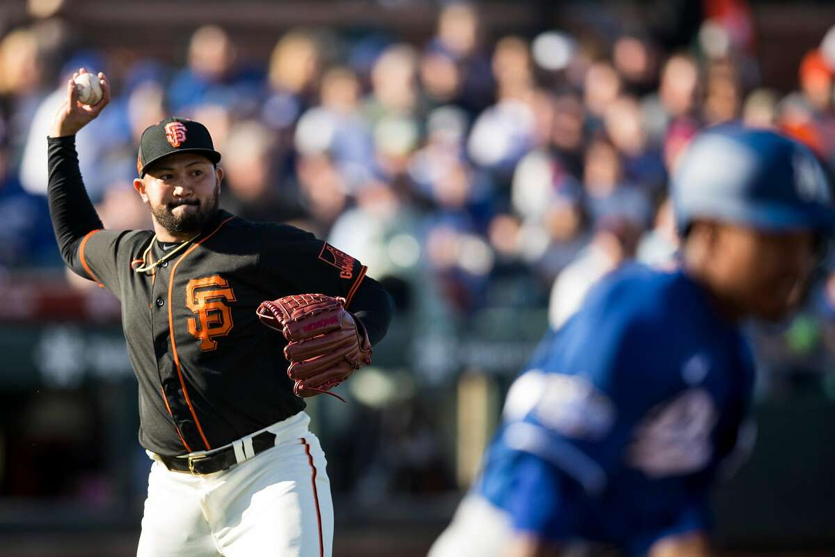 SCOTTSDALE, AZ - FEBRUARY 22: Rico Garcia #46 of the San Francisco Giants throws to first base during the game against the Los Angeles Dodgers on Saturday, February 22, 2020 at Scottsdale Stadium in Scottsdale, Arizona. (Photo by Adam Glanzman/MLB Photos via Getty Images)