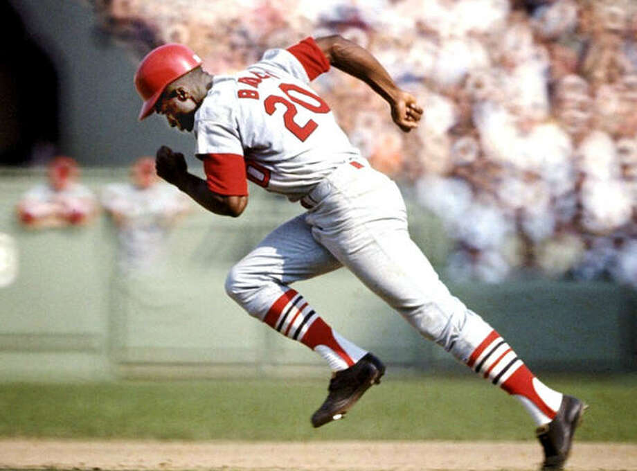 Lou Brock heads for a stolen base against the Boston Red Sox in the 1967 World Series. Brock died Sunday at the age of 81. Photo: File Photo