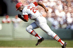 Lou Brock heads for a stolen base against the Boston Red Sox in the 1967 World Series. Brock died Sunday at the age of 81.