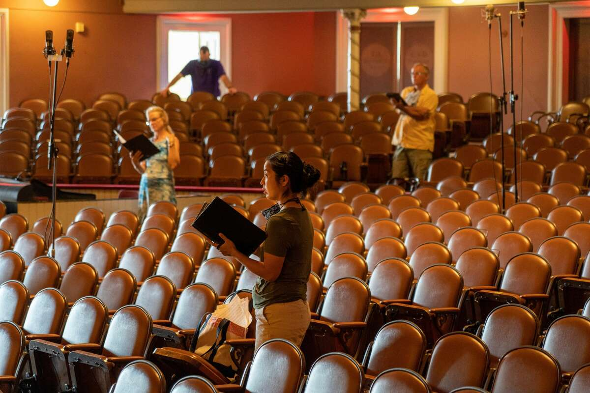 Members of Albany Pro Musica stand in the Troy Savings Bank Music Hall recently to record music for the group's 40th season, which will be shown on WMHT-TV and online. (Photo by Joe Fazioli for Albany Pro Musica.)