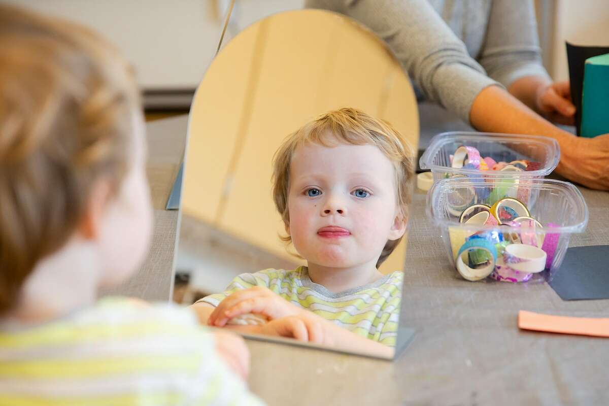 Ronan Mendel, 3, plays with clay and a mirror at Holy Family Day Home in San Francisco, Calif. on September 3, 2020. Like many preschools, Holy Family Day Home is incorporating a kindergarten program into it's preschool system in order to meet demand from parents unable to supervise distance learning for their children at home.