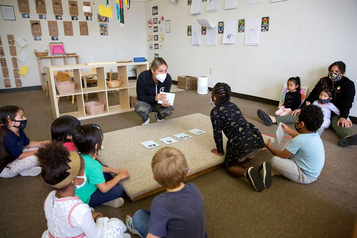 Holy Family Day Home teacher Bianca Carmelino leads an exercise with her preschool and kindergarten aged students at Holy Family Day Home in San Francisco, Calif. on September 3, 2020. Like many preschools, Holy Family Day Home is incorporating a kindergarten program into it's preschool system in order to meet demand from parents unable to supervise distance learning for their children at home.