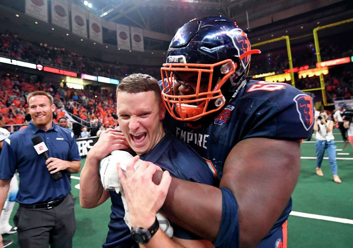 Albany Empire's Ryan Cave (68) celebrates with head coach Rob Keefe after a 45-27 win against the Philadelphia Soul during the ArenaBowl XXXII football game at the Times Union Center, Sunday, Aug. 11, 2019, in Albany, N.Y. (Hans Pennink / Special to the Times Union)