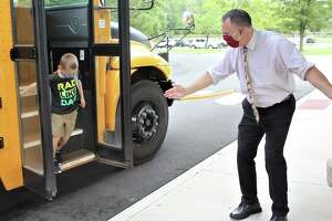 Middletown Public Schools began the 2020-21 academic year Thursday. Show are students getting off their buses and queuing up on blue dots placed six feet apart. All , including students and staff, must enter the buildings in this way, where they will be thermal scanned for temperatures to avoid a possible spread of the coronavirus.Superintendent of Schools Michael ConnerLawrence Elementary School