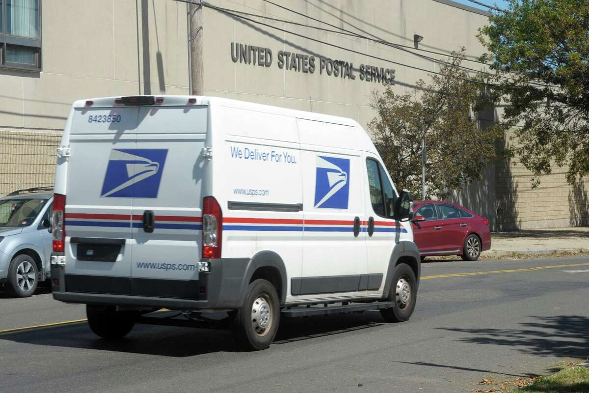 A file photo of a U.S. Postal Service truck in New Haven, Conn.