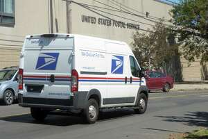 A file photo of a U.S. Postal Service truck in Connecticut.