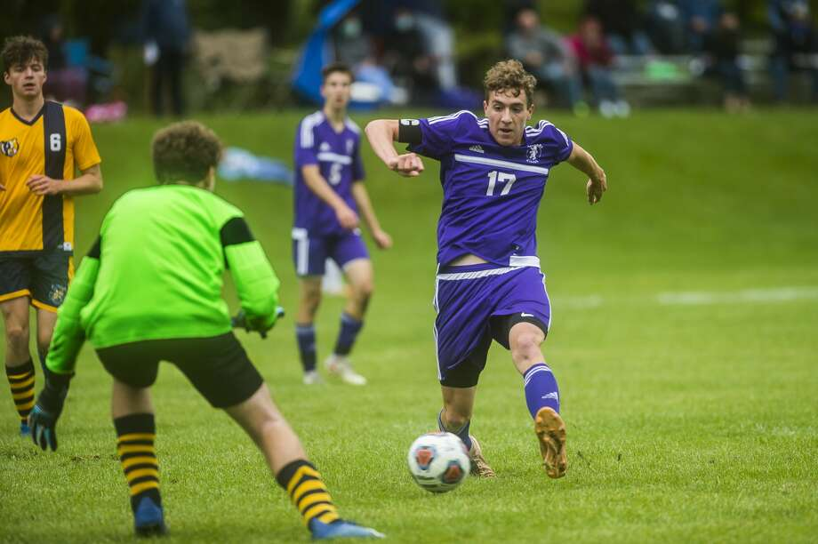 Calvary Baptist's Toby Stauffer takes a shot on goal, scoring during a game against Bethany Christian Tuesday, Sept. 8, 2020 at Calvary. (Katy Kildee/kkildee@mdn.net) Photo: (Katy Kildee/kkildee@mdn.net)