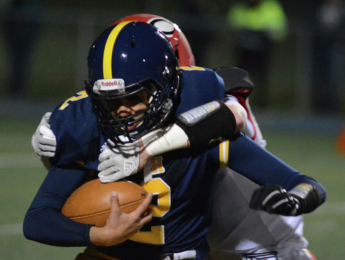 East Haven quarterback Trey Garea is tackled by a Cheshire defender on Friday night.