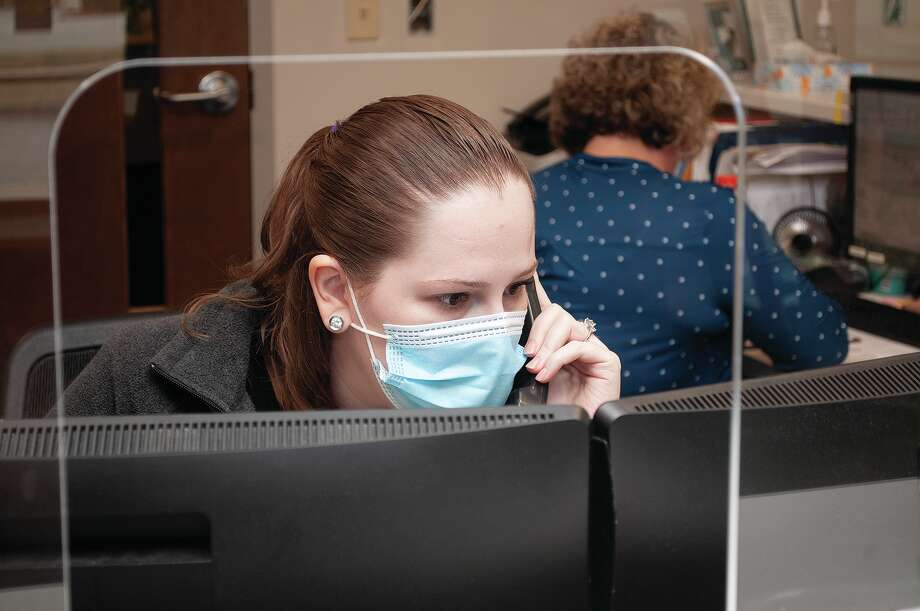 Julia Gound works with patients over the phone while working with Lisa Farmer (back) at the Springfield Clinic Urgent Care on Morton Avenue. The clilnic is undergoing renovations. Photo: Darren Iozia | Journal-Courier / Jacksonville Journal-Courier
