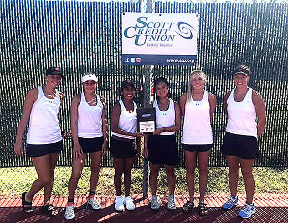 Edwardsville tennis players, left to right, Morgan Marshall, Grace Hackett, Chloe Trimpe, Chloe Koons, Emma Herman and Hannah Colbert pose the championship plaque Saturday after taking first place in the Champions flight of the Heather Bradshaw Memorial Invitational. Photo: For The Intelligencer