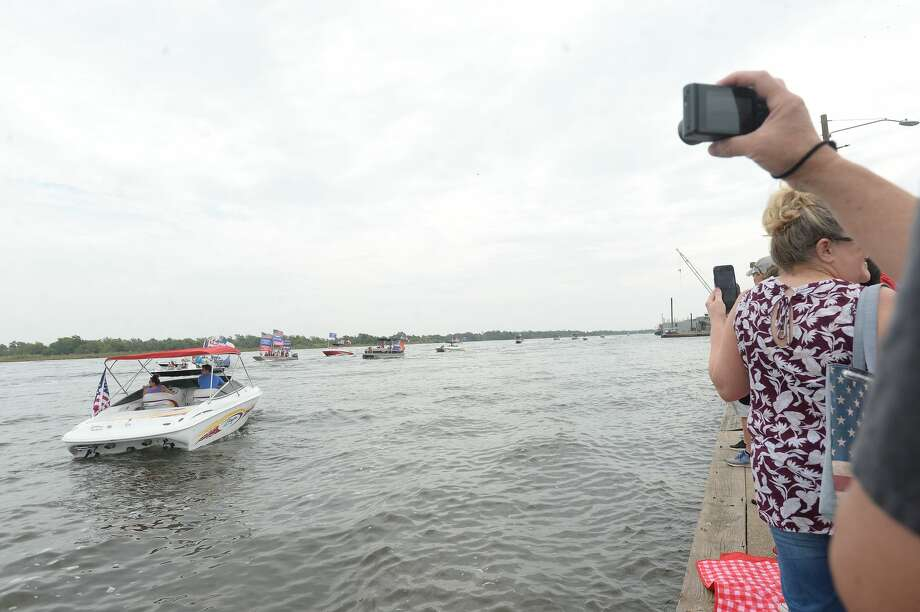 """during Saturday's Trump Boat Parade 2020 up the Neches River. Crowds packed the riverfront in Port Neches to cheer on the hundreds of boats as they passed, chanting """"4 more years"""" and waving flags in support. Photo taken Saturday, September 5, 2020 Kim Brent/The Enterprise Photo: Kim Brent/The Enterprise"""