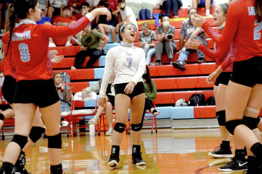 Lumberton's Ivy Le and teammates celebrate a point over Evadale during Tuesday's game in Lumberton. Photo taken Tuesday, September 8, 2020 Kim Brent/The Enterprise Photo: Kim Brent / The Enterprise / BEN