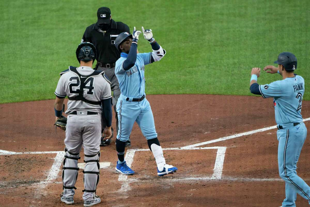 BUFFALO, NY - SEPTEMBER 08: Toronto Blue Jays Right Fielder Jonathan Davis (49) reacts crossing home plate after hitting a two run home run during the second inning of the Major League Baseball game between the New York Yankees and the Toronto Blue Jays on September 8, 2020, at Sahlen Field in Buffalo, NY. (Photo by Gregory Fisher/Icon Sportswire via Getty Images)