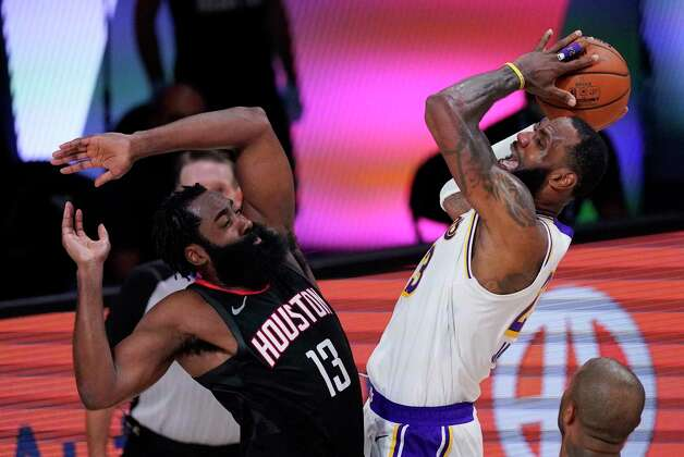 Los Angeles Lakers' LeBron James, right, shoots over Houston Rockets' James Harden (13) during the second half of an NBA conference semifinal playoff basketball game Tuesday, Sept. 8, 2020, in Lake Buena Vista, Fla. (AP Photo/Mark J. Terrill) Photo: Mark J. Terrill, Associated Press / Copyright 2020 The Associated Press. All rights reserved.
