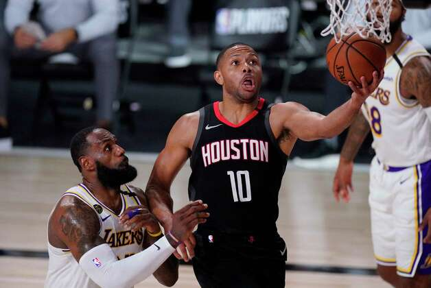 Houston Rockets' Eric Gordon (10) drives to the basket ahead of Los Angeles Lakers' LeBron James, left, during the second half of an NBA conference semifinal playoff basketball game Tuesday, Sept. 8, 2020, in Lake Buena Vista, Fla. (AP Photo/Mark J. Terrill) Photo: Mark J. Terrill, Associated Press / Copyright 2020 The Associated Press. All rights reserved.