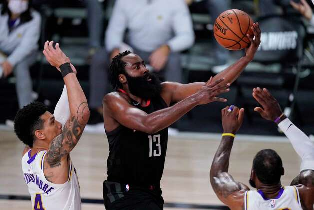Houston Rockets' James Harden (13) drives to the basket between Los Angeles Lakers' Danny Green, left, and LeBron James, right, during the second half of an NBA conference semifinal playoff basketball game Tuesday, Sept. 8, 2020, in Lake Buena Vista, Fla. (AP Photo/Mark J. Terrill) Photo: Mark J. Terrill, Associated Press / Copyright 2020 The Associated Press. All rights reserved.