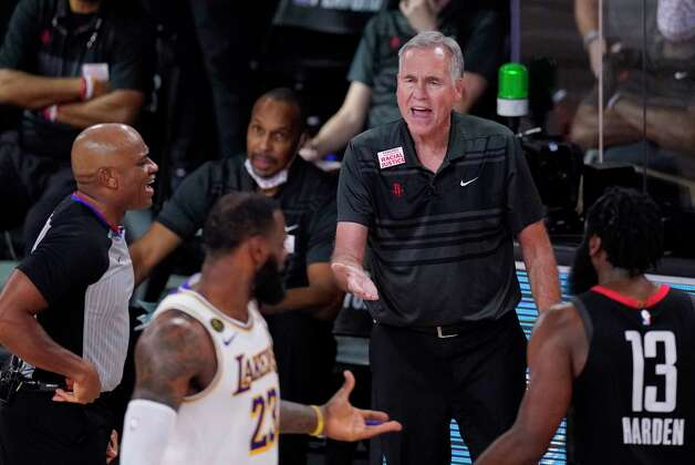 Houston Rockets head coach Mike D'Antoni, center, and James Harden (13) question a call during the second half of an NBA conference semifinal playoff basketball game against the Los Angeles Lakers Tuesday, Sept. 8, 2020, in Lake Buena Vista, Fla. (AP Photo/Mark J. Terrill) Photo: Mark J. Terrill, Associated Press / Copyright 2020 The Associated Press. All rights reserved.