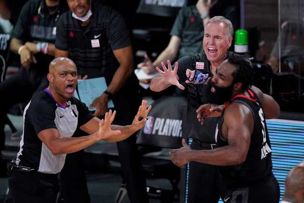 Houston Rockets head coach Mike D'Antoni, center, and James Harden, right, question a call during the second half of an NBA conference semifinal playoff basketball game against the Los Angeles Lakers Tuesday, Sept. 8, 2020, in Lake Buena Vista, Fla. (AP Photo/Mark J. Terrill) Photo: Mark J. Terrill, Associated Press / Copyright 2020 The Associated Press. All rights reserved.