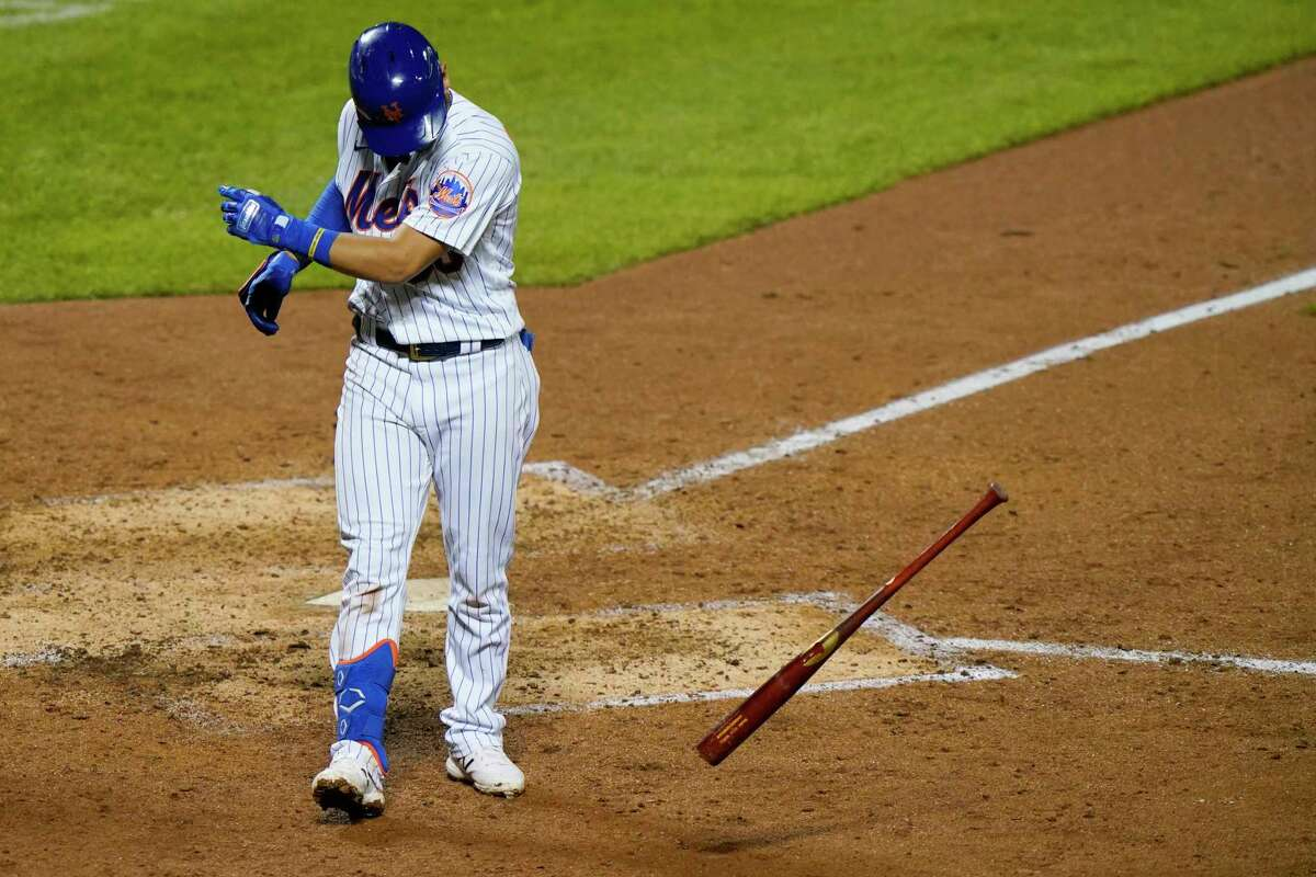 New York Mets' Andres Gimenez tosses his bat after striking out swinging, stranding a runner on second in the seventh inning of the team's baseball game against the Baltimore Orioles, Tuesday, Sept. 8, 2020, in New York. (AP Photo/Kathy Willens)