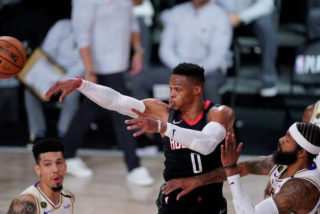 Houston Rockets' Russell Westbrook (0) passes between Los Angeles Lakers' Danny Green, left, and Markieff Morris, right, during the second half of an NBA conference semifinal playoff basketball game Tuesday, Sept. 8, 2020, in Lake Buena Vista, Fla. (AP Photo/Mark J. Terrill) Photo: Mark J. Terrill, Associated Press / Copyright 2020 The Associated Press. All rights reserved.