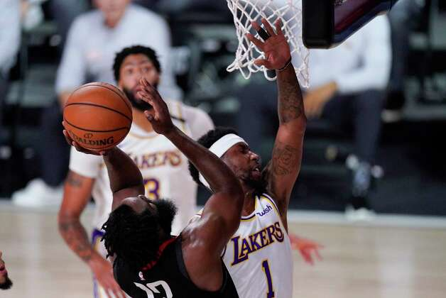 Houston Rockets' James Harden (13) drives to the basket in front of Los Angeles Lakers' Kentavious Caldwell-Pope (1) during the second half of an NBA conference semifinal playoff basketball game Tuesday, Sept. 8, 2020, in Lake Buena Vista, Fla. (AP Photo/Mark J. Terrill) Photo: Mark J. Terrill, Associated Press / Copyright 2020 The Associated Press. All rights reserved.