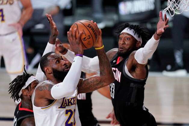Los Angeles Lakers' LeBron James (23) drives to the basket past Houston Rockets' Robert Covington (33) during the first half of an NBA conference semifinal playoff basketball game Tuesday, Sept. 8, 2020, in Lake Buena Vista, Fla. (AP Photo/Mark J. Terrill) Photo: Mark J. Terrill, Associated Press / Copyright 2020 The Associated Press. All rights reserved.
