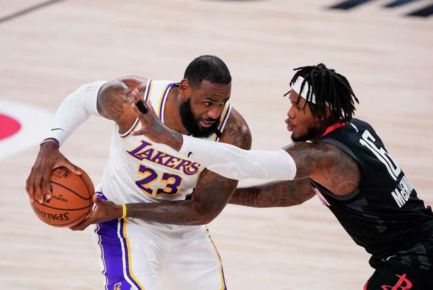 Los Angeles Lakers' LeBron James (23) drives around Houston Rockets' Ben McLemore (16) during the first half of an NBA conference semifinal playoff basketball game Tuesday, Sept. 8, 2020, in Lake Buena Vista, Fla. (AP Photo/Mark J. Terrill) Photo: Mark J. Terrill, Associated Press / Copyright 2020 The Associated Press. All rights reserved.
