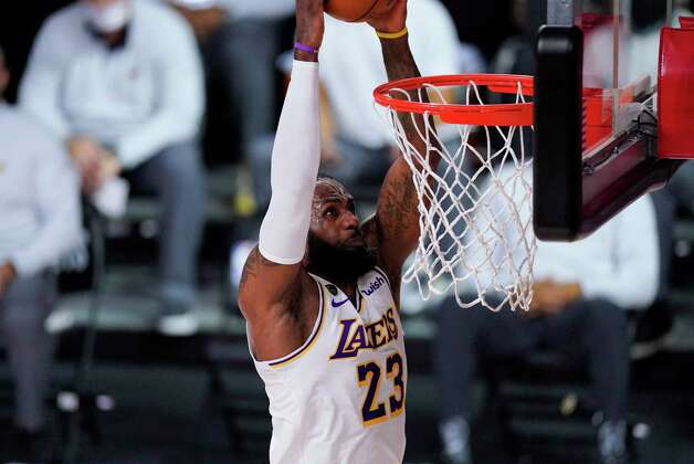 Los Angeles Lakers' LeBron James (23) dunks the ball during the first half of an NBA conference semifinal playoff basketball game against the Houston Rockets Tuesday, Sept. 8, 2020, in Lake Buena Vista, Fla. (AP Photo/Mark J. Terrill) Photo: Mark J. Terrill, Associated Press / Copyright 2020 The Associated Press. All rights reserved.