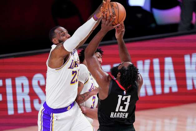 Los Angeles Lakers' LeBron James, left, tries to block a shot by Houston Rockets' James Harden (13) during the first half of an NBA conference semifinal playoff basketball game Tuesday, Sept. 8, 2020, in Lake Buena Vista, Fla. (AP Photo/Mark J. Terrill) Photo: Mark J. Terrill, Associated Press / Copyright 2020 The Associated Press. All rights reserved.