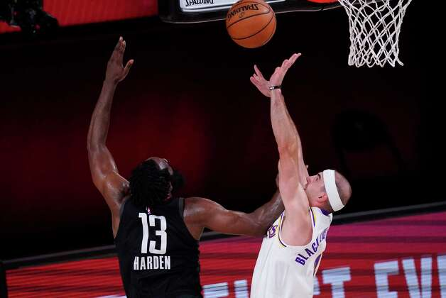 Houston Rockets' James Harden (13) shoots over Los Angeles Lakers' Alex Caruso, right, during the first half of an NBA conference semifinal playoff basketball game Tuesday, Sept. 8, 2020, in Lake Buena Vista, Fla. (AP Photo/Mark J. Terrill) Photo: Mark J. Terrill, Associated Press / Copyright 2020 The Associated Press. All rights reserved.