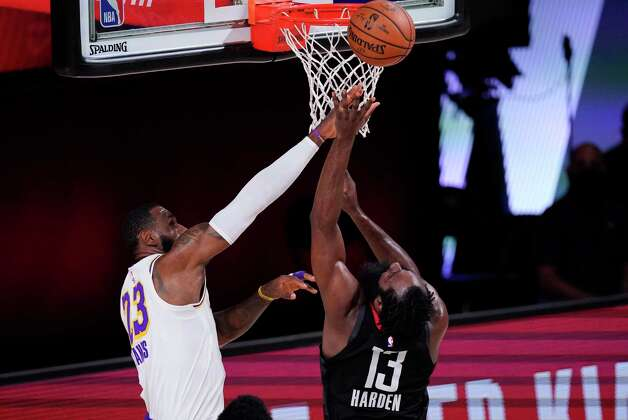 Los Angeles Lakers' LeBron James (23) tries to block a shot by Houston Rockets' James Harden (13) during the first half of an NBA conference semifinal playoff basketball game Tuesday, Sept. 8, 2020, in Lake Buena Vista, Fla. (AP Photo/Mark J. Terrill) Photo: Mark J. Terrill, Associated Press / Copyright 2020 The Associated Press. All rights reserved.