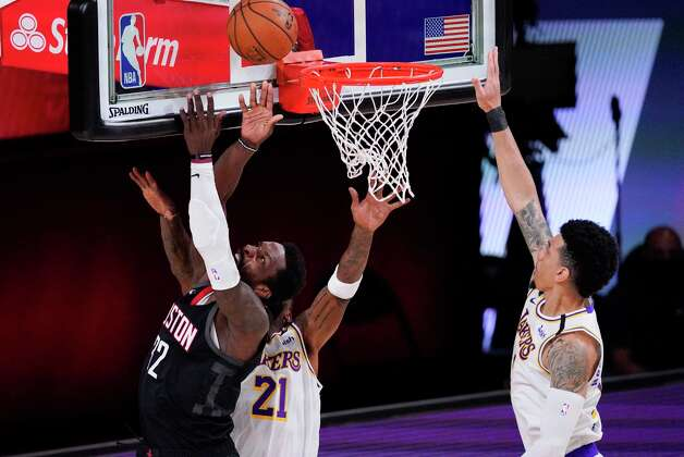 Houston Rockets' Jeff Green (32) shoots over Los Angeles Lakers' JR Smith (21) and Danny Green, right, during the first half of an NBA conference semifinal playoff basketball game Tuesday, Sept. 8, 2020, in Lake Buena Vista, Fla. (AP Photo/Mark J. Terrill) Photo: Mark J. Terrill, Associated Press / Copyright 2020 The Associated Press. All rights reserved.