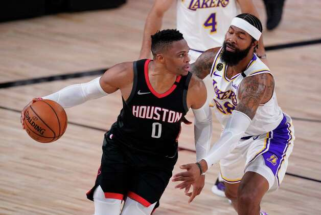 Houston Rockets' Russell Westbrook (0) drives around Los Angeles Lakers' Markieff Morris, right, during the first half of an NBA conference semifinal playoff basketball game Tuesday, Sept. 8, 2020, in Lake Buena Vista, Fla. (AP Photo/Mark J. Terrill) Photo: Mark J. Terrill, Associated Press / Copyright 2020 The Associated Press. All rights reserved.