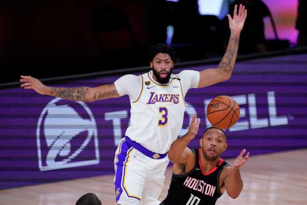Houston Rockets' Eric Gordon (10) grabs a rebound ahead of Los Angeles Lakers' Anthony Davis (3) during the first half of an NBA conference semifinal playoff basketball game Tuesday, Sept. 8, 2020, in Lake Buena Vista, Fla. (AP Photo/Mark J. Terrill) Photo: Mark J. Terrill, Associated Press / Copyright 2020 The Associated Press. All rights reserved.