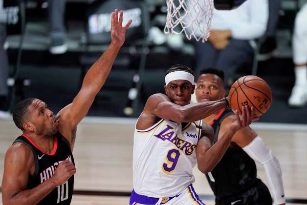 Los Angeles Lakers' Rajon Rondo (9) passes in front of Houston Rockets' Eric Gordon (10) during the first half of an NBA conference semifinal playoff basketball game Tuesday, Sept. 8, 2020, in Lake Buena Vista, Fla. (AP Photo/Mark J. Terrill) Photo: Mark J. Terrill, Associated Press / Copyright 2020 The Associated Press. All rights reserved.