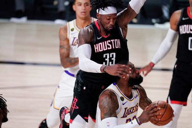 Los Angeles Lakers' LeBron James is fouled by Houston Rockets' Robert Covington (33) during the first half of an NBA conference semifinal playoff basketball game Tuesday, Sept. 8, 2020, in Lake Buena Vista, Fla. (AP Photo/Mark J. Terrill) Photo: Mark J. Terrill, Associated Press / Copyright 2020 The Associated Press. All rights reserved.