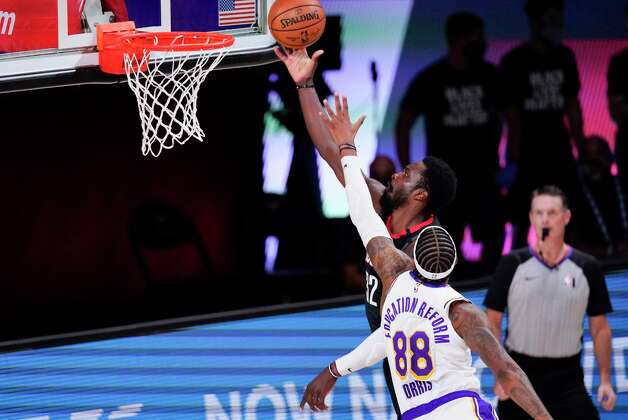 Houston Rockets' Jeff Green (32) drives to the basket ahead of Los Angeles Lakers' Markieff Morris (88) during the first half of an NBA conference semifinal playoff basketball game Tuesday, Sept. 8, 2020, in Lake Buena Vista, Fla. (AP Photo/Mark J. Terrill) Photo: Mark J. Terrill, Associated Press / Copyright 2020 The Associated Press. All rights reserved.