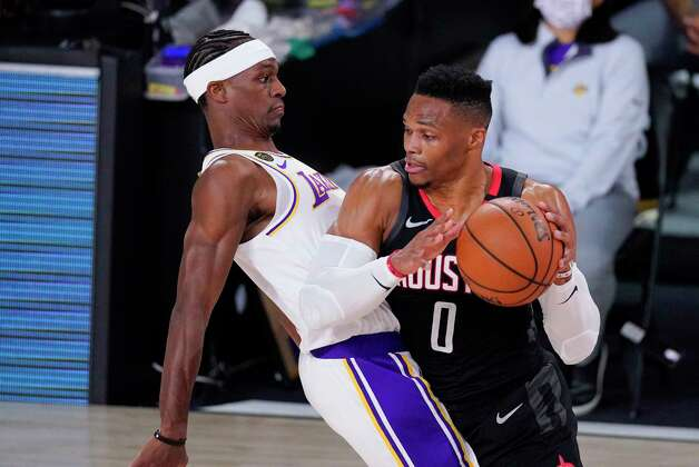Houston Rockets' Russell Westbrook (0) drives around Los Angeles Lakers' Rajon Rondo during the first half of an NBA conference semifinal playoff basketball game Tuesday, Sept. 8, 2020, in Lake Buena Vista, Fla. (AP Photo/Mark J. Terrill) Photo: Mark J. Terrill, Associated Press / Copyright 2020 The Associated Press. All rights reserved.