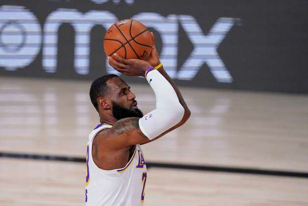 Los Angeles Lakers' LeBron James (23) shoots a free throw during the first half of an NBA conference semifinal playoff basketball game against the Houston Rockets Tuesday, Sept. 8, 2020, in Lake Buena Vista, Fla. (AP Photo/Mark J. Terrill) Photo: Mark J. Terrill, Associated Press / Copyright 2020 The Associated Press. All rights reserved.
