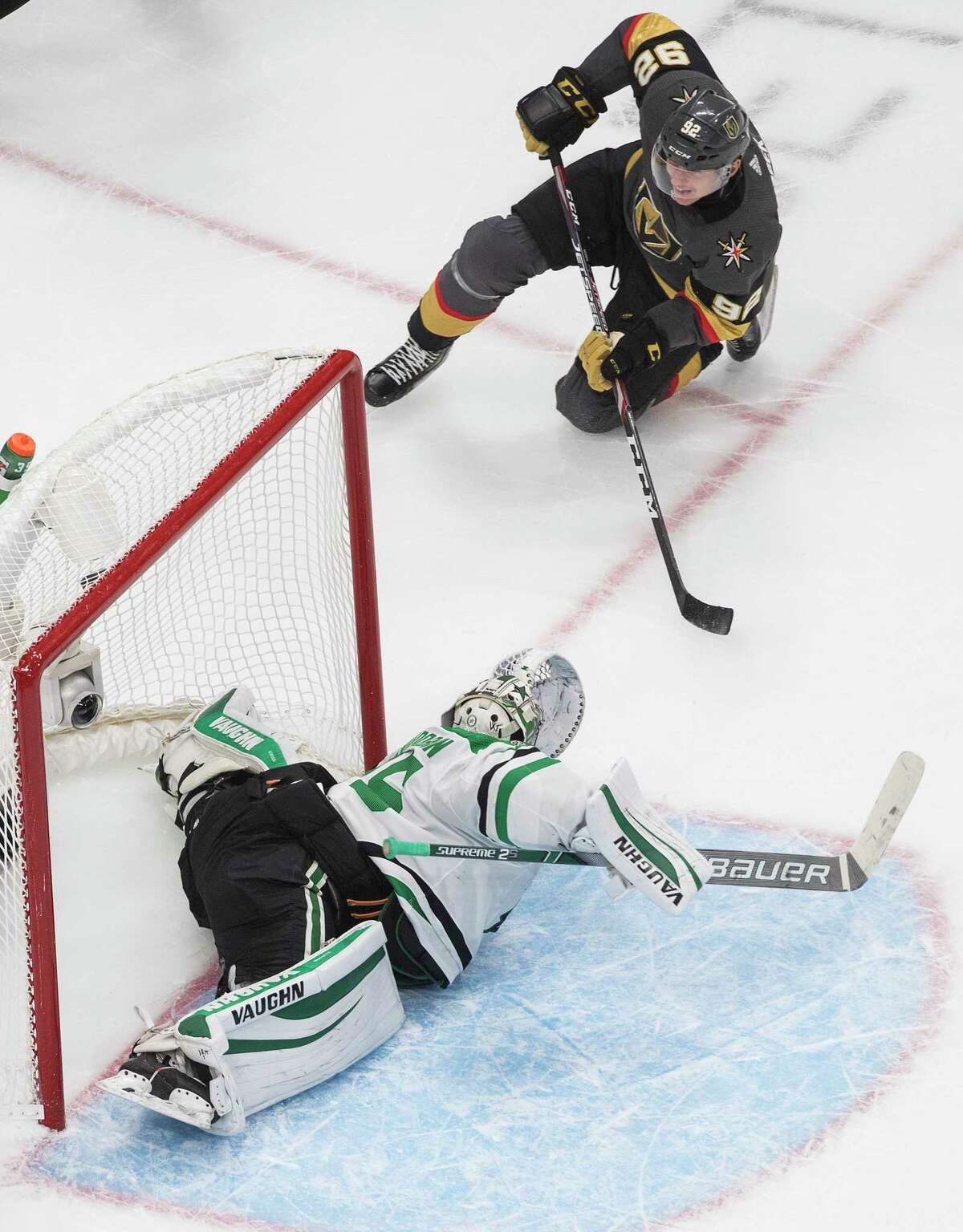 Dallas Stars goalie Anton Khudobin (35) gives up a goal as Vegas Golden Knights' Tomas Nosek watches during the second period of Game 2 of the NHL hockey Western Conference final, Tuesday, Sept. 8, 2020, in Edmonton, Alberta. (Jason Franson/The Canadian Press via AP)